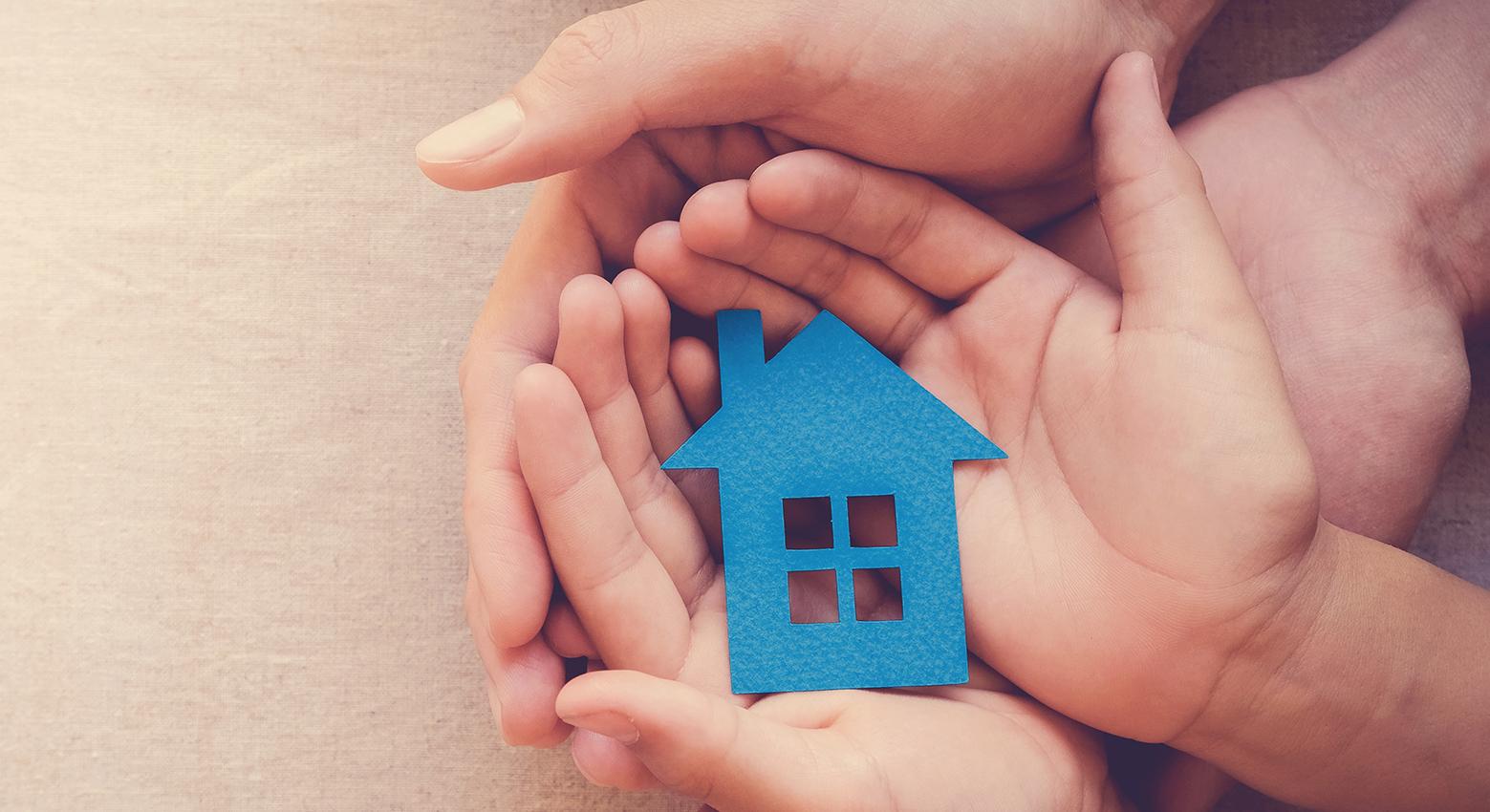 hands holding paper house, family home, homeless shelter, intern