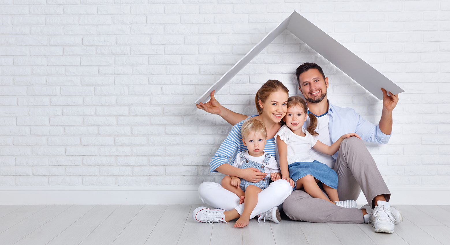 concept housing a young family. mother father and children in new home